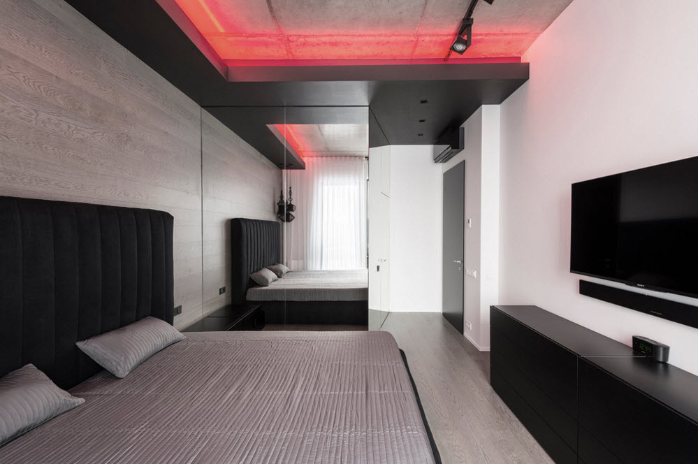Unusual bedroom ceiling with two-level structure and red backlight