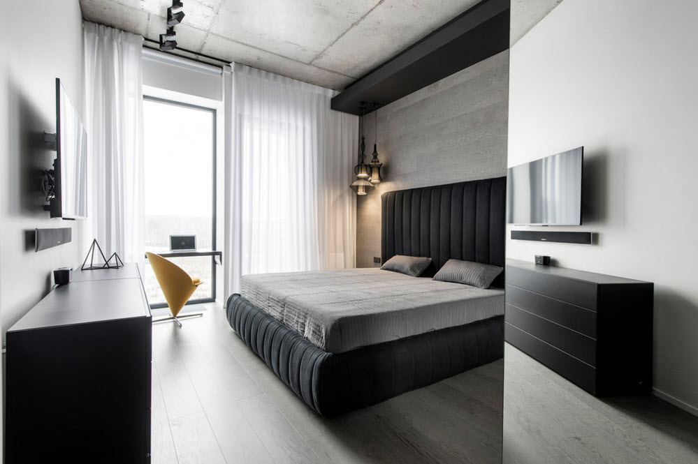 Large bed and contrasting decoration