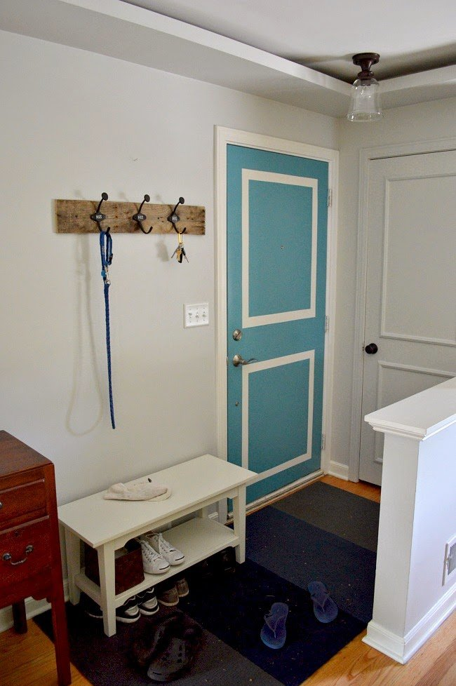 Simple decorated small hallway with blue door