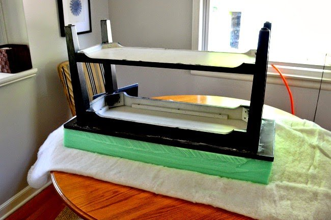 Black wooden table for the diy shoe rack: fitting the foam by size