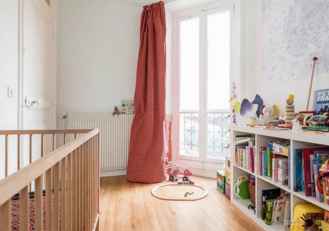 Red curtain for the modern styled nursery in white and with laminated floor