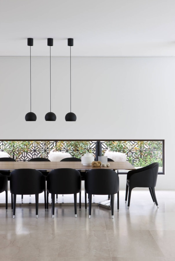 Black Dining Room Set for Different Interior Styles. Ultramodern design of the space with low windows and high ceiling