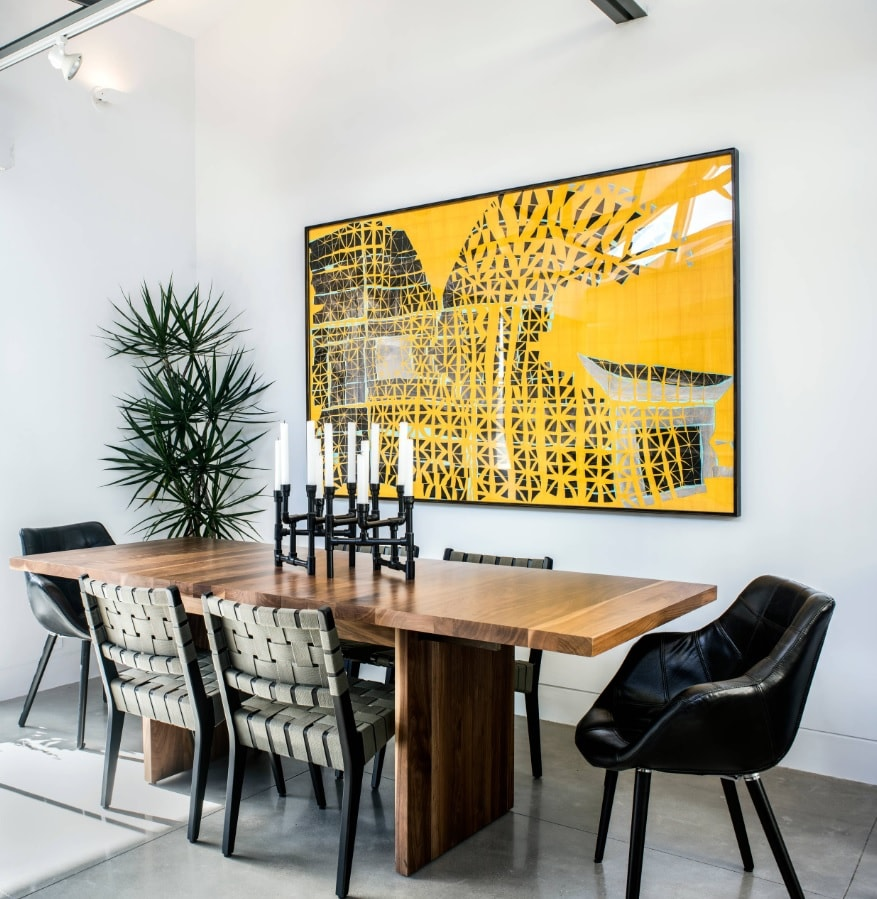 Yellow impressionistic picture to decorate modern styled dining room