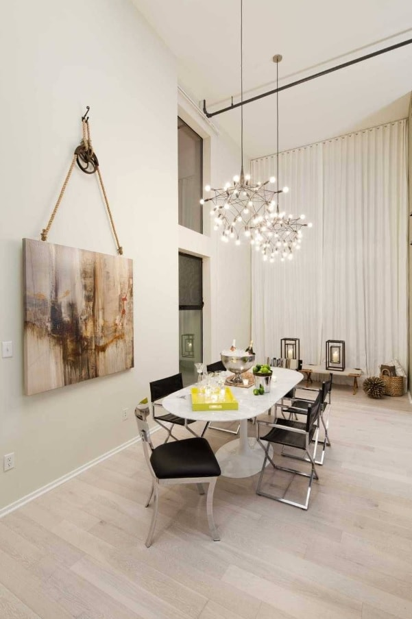 Large picture on the rope to decorate modern designed dining room