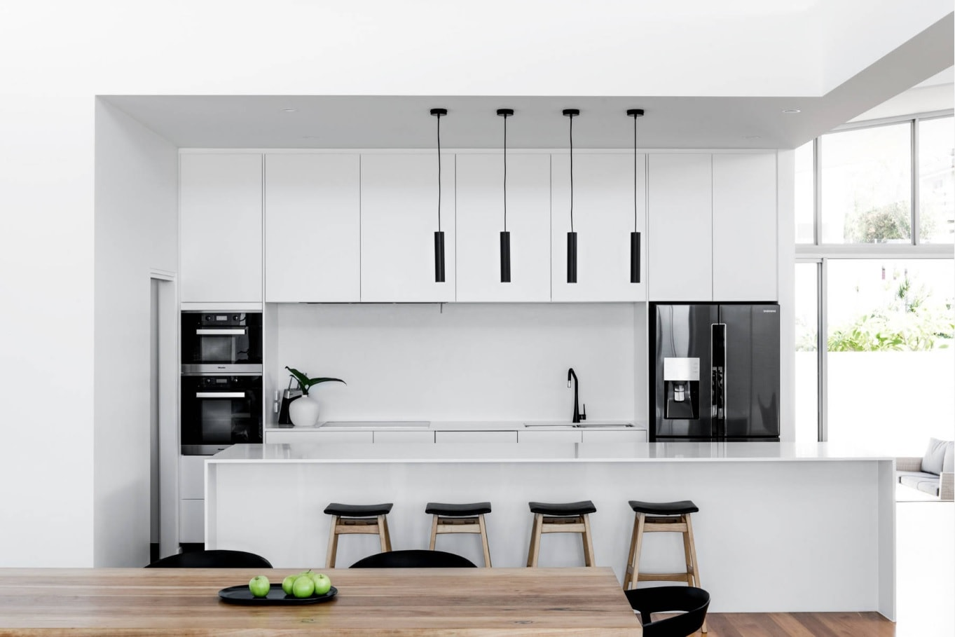 Kitchen and dining room combined space and the black/white color theme