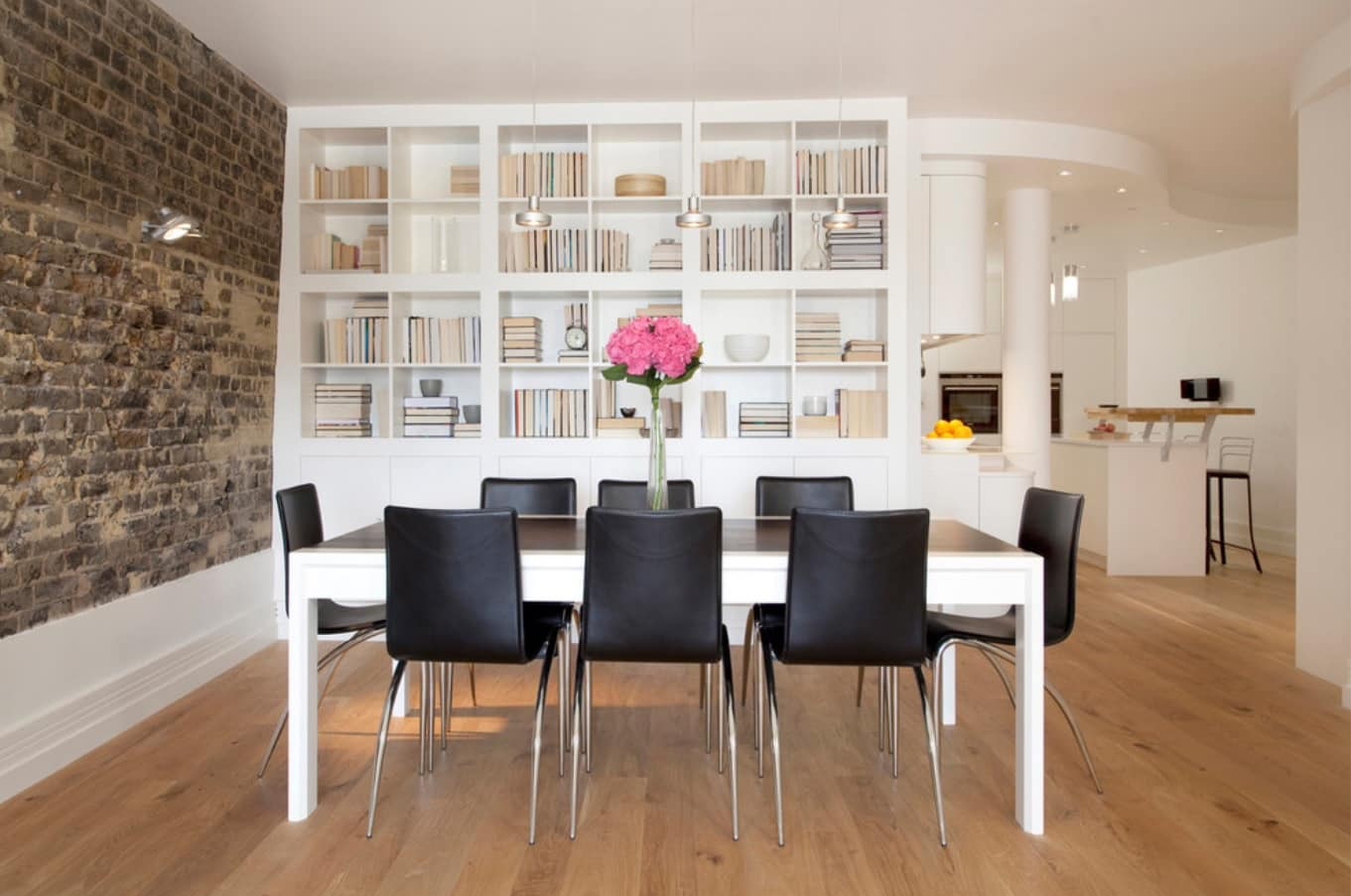 Black dining set for Casual styled room with open bookshelf