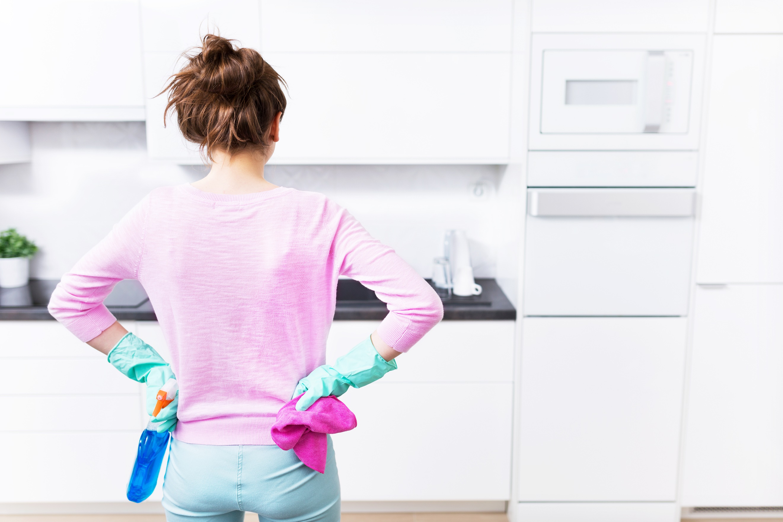 How a Clean Kitchen Equals Money in Your Pocket. Housewife and the white kitchen