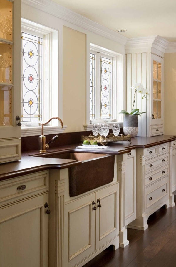Copper Decoration Elements as Fashionable Interior Design Trend. Classic kitchen with bent tap and metal sink
