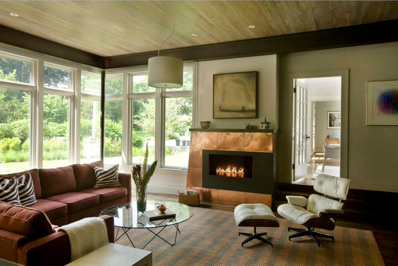 Copper Decoration Elements as Fashionable Interior Design Trend. Shining metall panel to emphasize the fireplace in Casual styled cottage