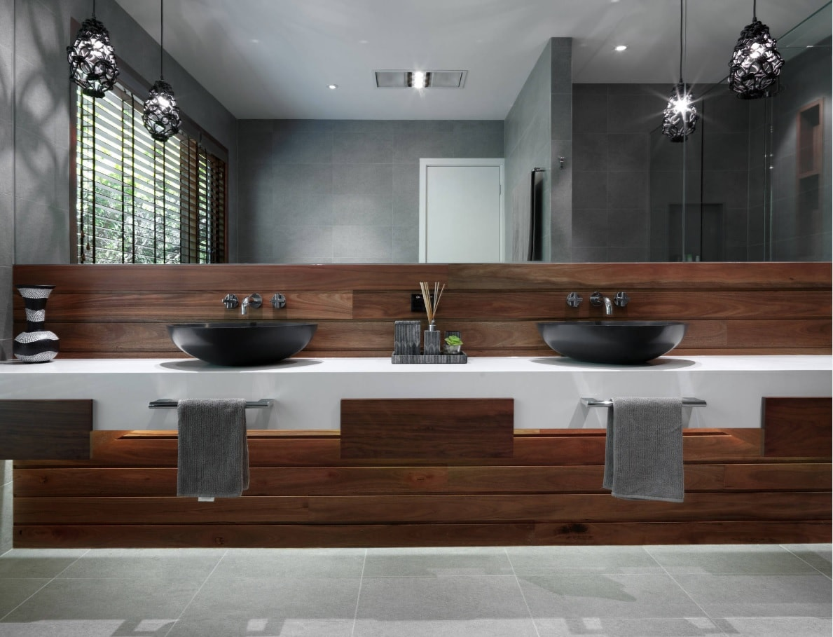 Ensuite Bathroom as the Way to Organize Space. Grandeur solution of wooden panel at the sink and vanity zone to emphasize unique modern style