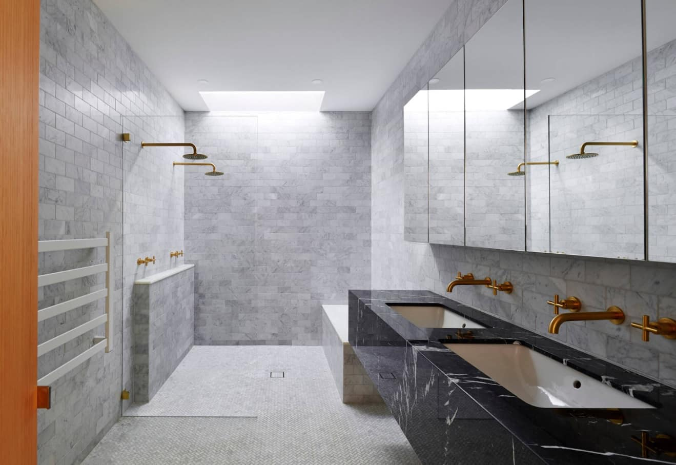 Ensuite Bathroom as the Way to Organize Space. Gray marble imitating tiles and dark marble vanity for top-notch styled bathroom