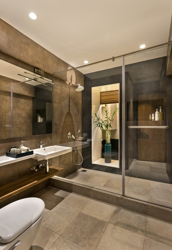 Brown and gray color theme for the masculine designed ensuite bathroom