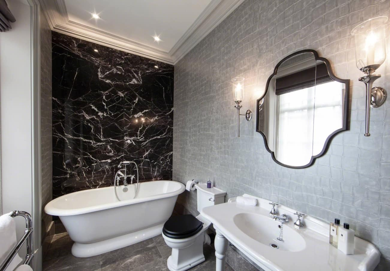 Noble dark marble with white streaks and large mirror in Classic styled bathroom