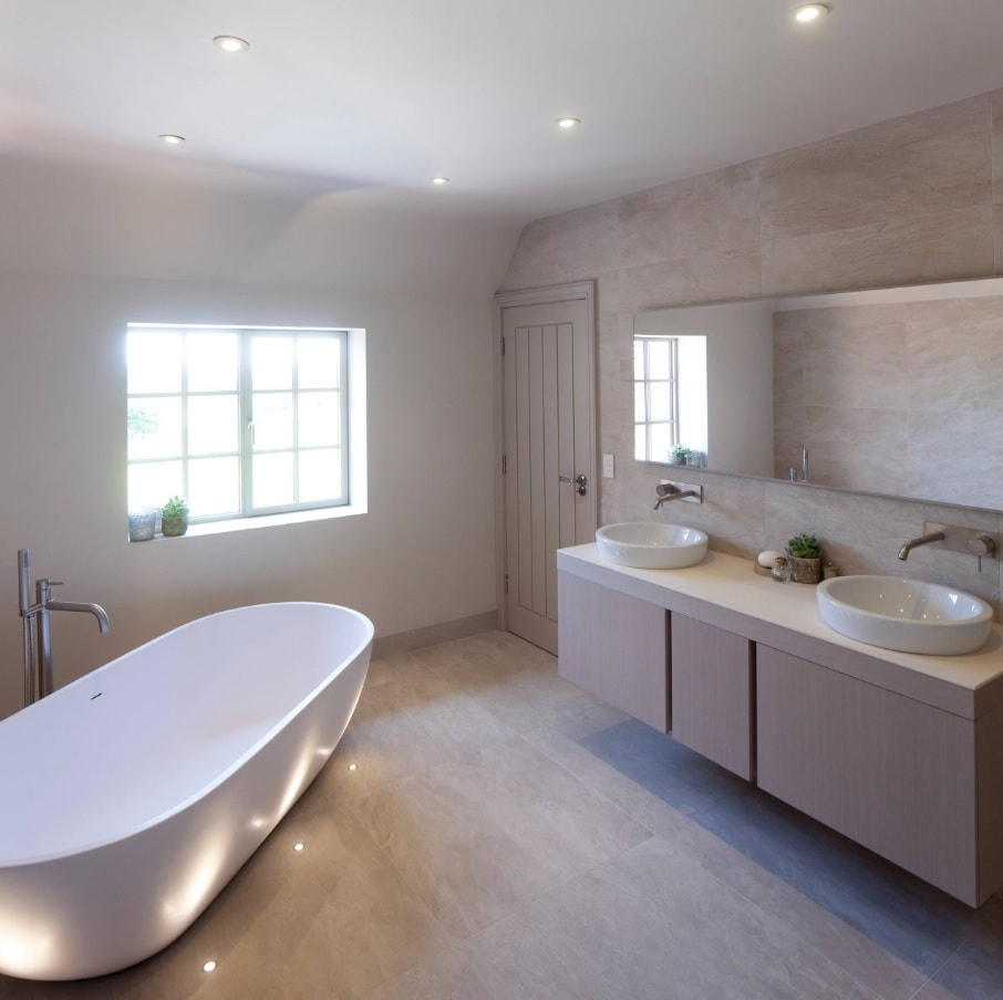 Gray cubicle of ensuite bathroom with built-in lighting