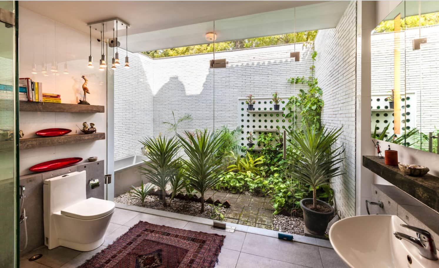 Unusual eco styled ensuite bathroom with panoramic window to the backyard