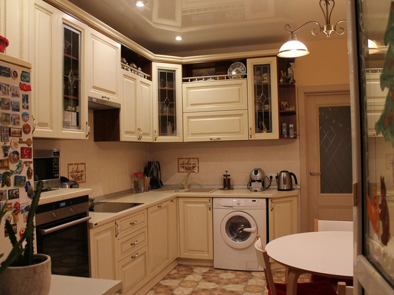 Multifunctional kitchen in light pastel with the washing machine