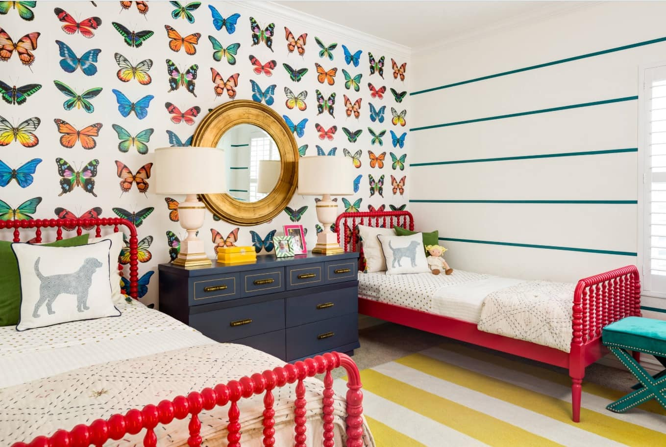 Kids Room Paint Creative Design Ideas. Colorful butterflies at the wall of Classic styled room with red frames of beds