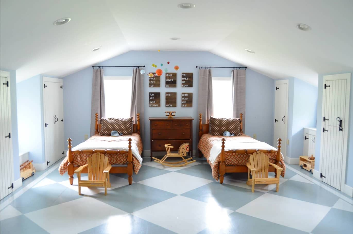 Loft kids room with large tiles for floor and pale blue colors for walls