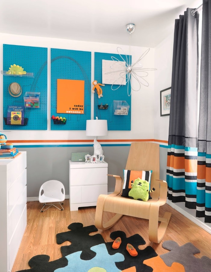 Azure colored kids room with toys and necessary furniture