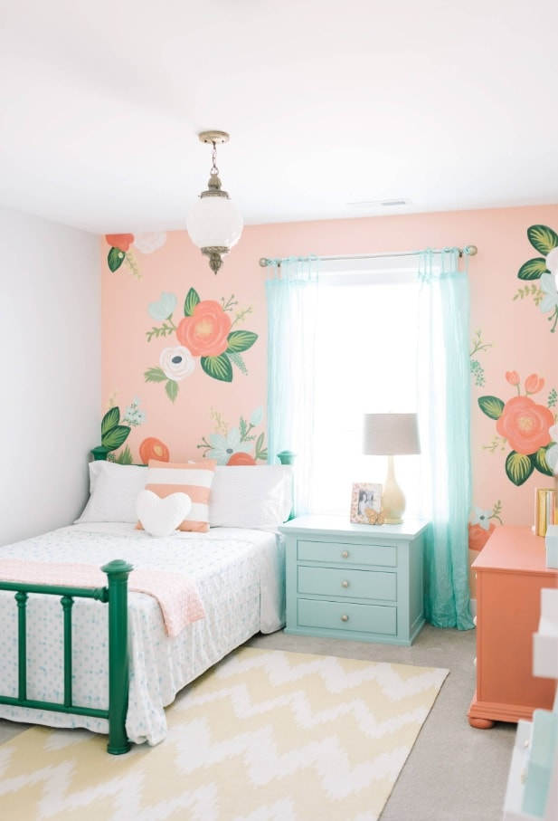 Pink painted walls in the kids room with flowers