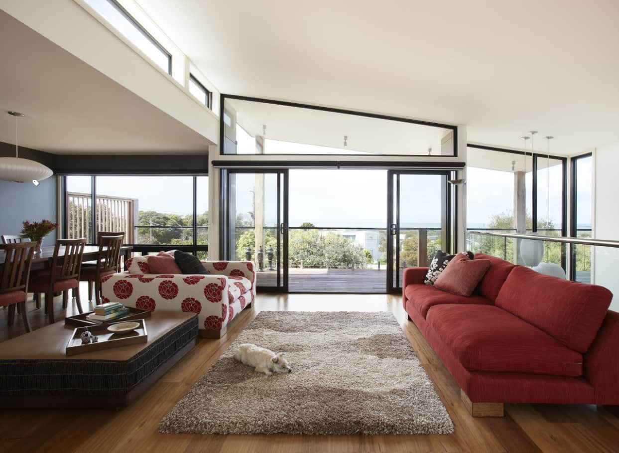 Loft sloped ceiling and panoramic windows for modern styled cottage with large sitting zone