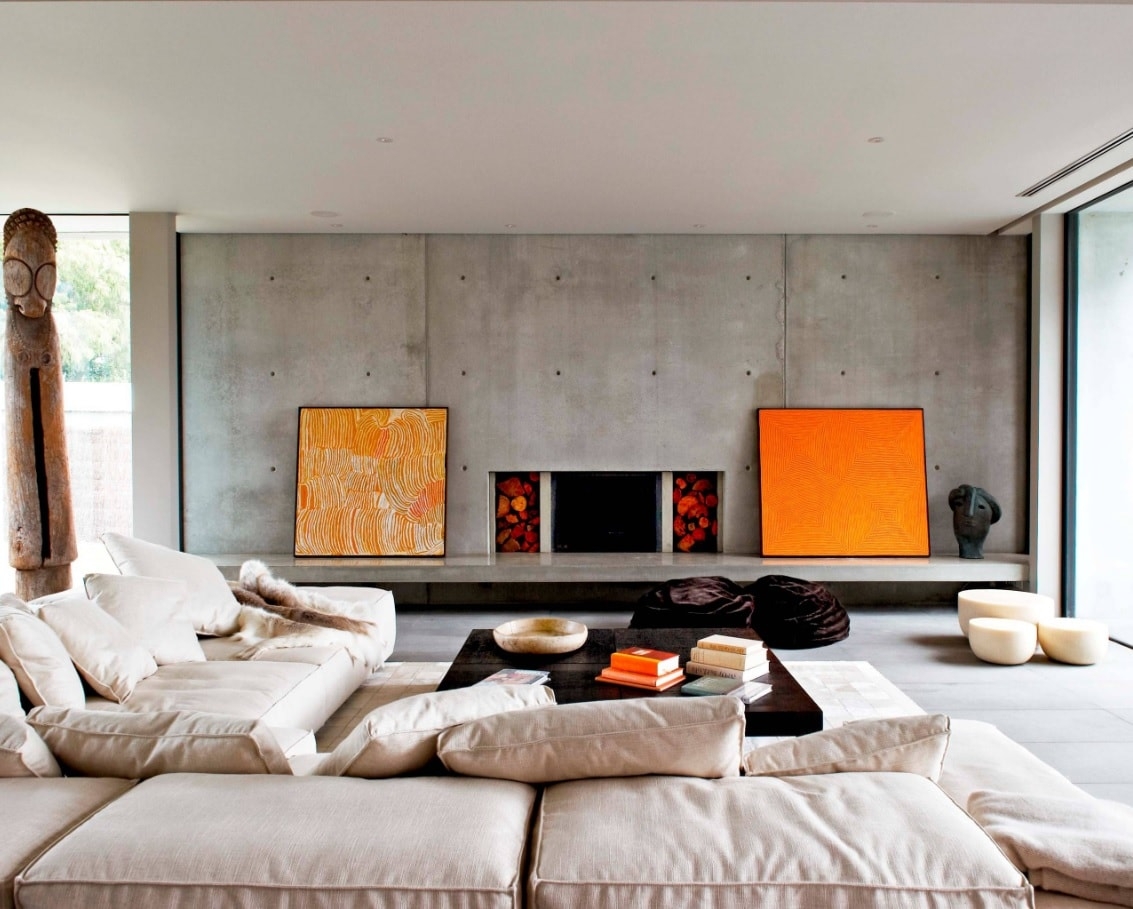 Lounge Room: What is It and Whether You Need it at Home? Gray accent functional wall with orange pictures and electric fireplace