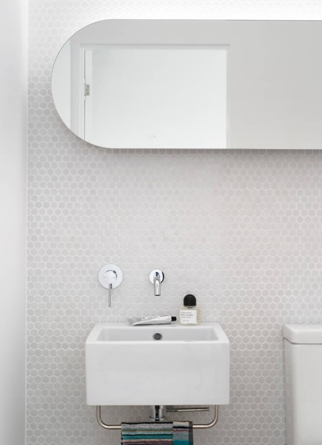 Simple concise design of the bathroom with textured wall covering