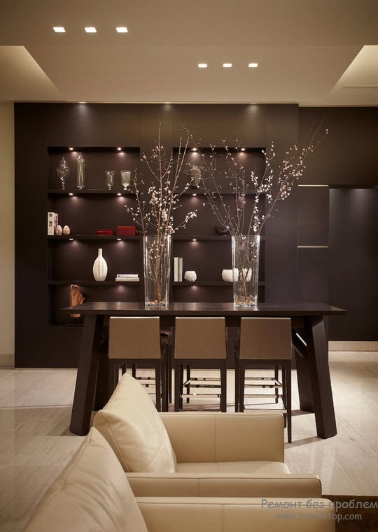 Dark accent wall with shelves for personal things in the dining room with dark wooden dining group