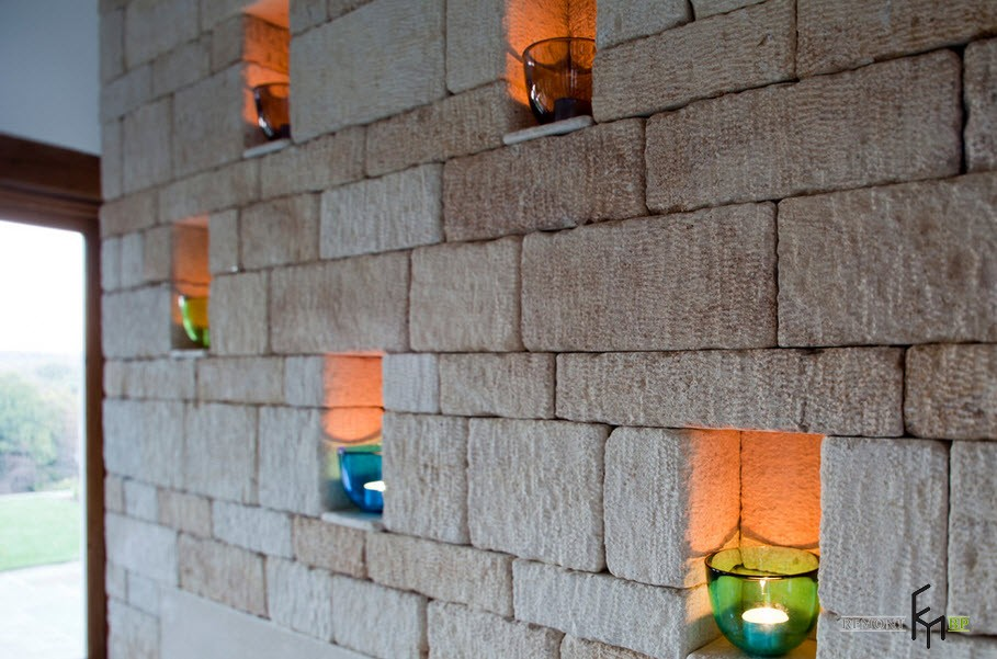 Solid stone wall with recesses for candles