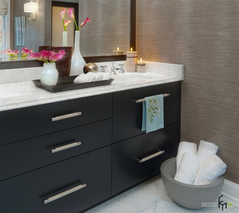 Candles and Candlesticks in the Modern Interior of Cozy Home. Black vanity and large mirror for pastel colored bathroom
