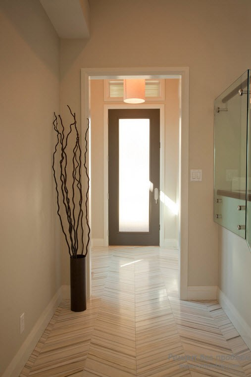 Light colored hallway with minimalistic arrangement and twigs in the vase