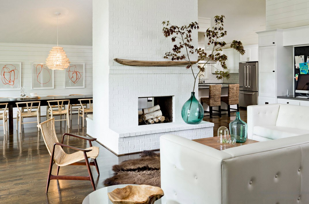 Homey Scandi design with central hearth and cozy armchair