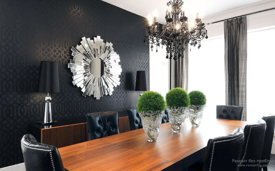 Vases in the Interior: Original Ideas on Decorating your Home. Black accent wall with starburst mirror and bonsai decorated crystal vases at the wooden table