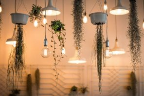 How To Make a Room Feel Bigger with Clever Lighting. Lamps on cords and plants in suspended pots
