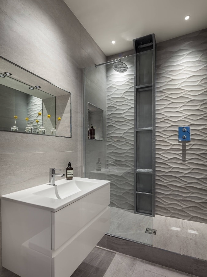 5 Key Tips for Remodeling a Small Bathroom. Striking wall panels with nice lighting