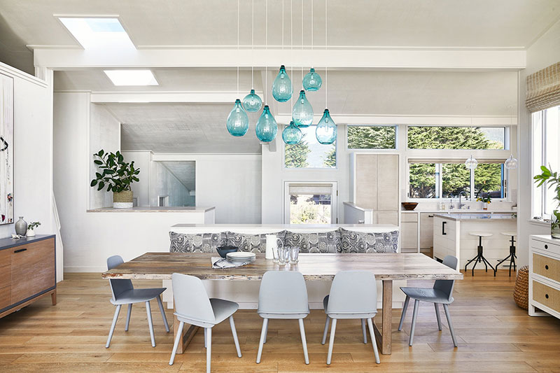 Sunny California Beach House Project in White. Turquoise lamps and white matte dining group
