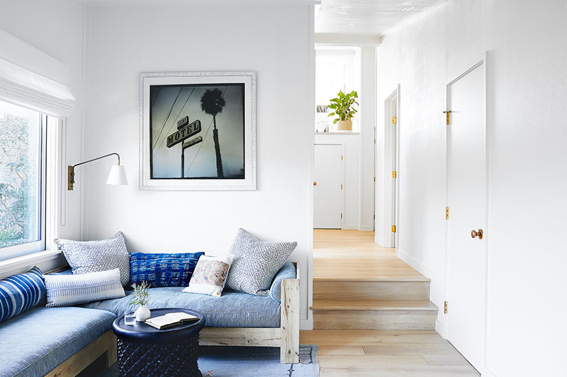 Sunny California Beach House Project in White. Hallway with steps and entrance to the living room
