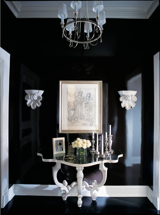 Black Interior Design Ideas and Tips to Make Your Interior. Absolutely dark hall interior with classic carved table and crystal chandelier