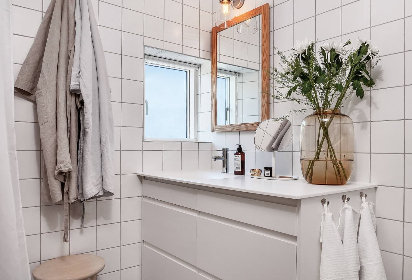 Nordic Interior Design Examples in Real Homes Photos. Metro tile in the bathroom with smooth vanity