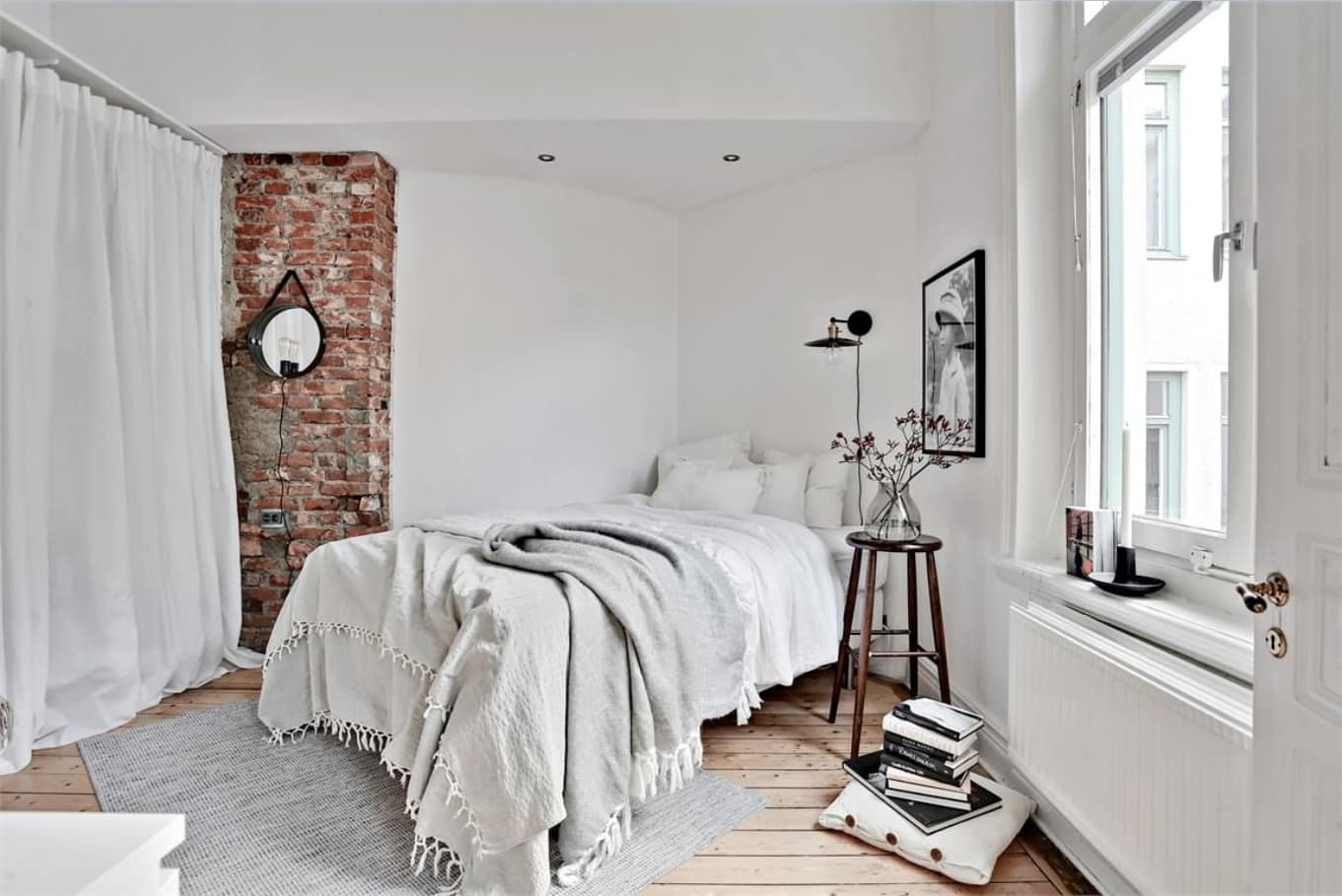 Exposed brickwork as the accent in the Nordic styled bedroom