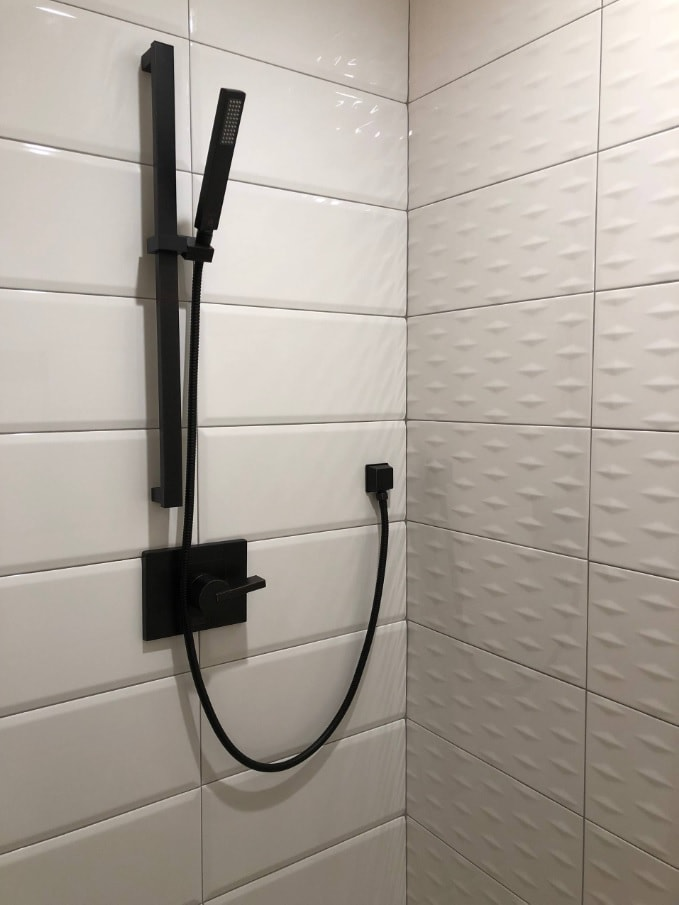 Very cozy shower zone with black tap
