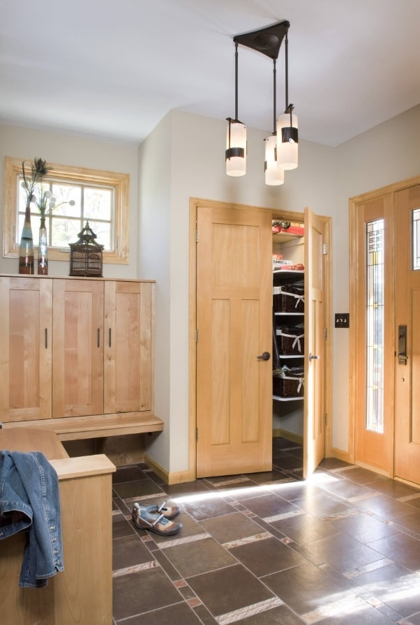 Inventive Ways to Make a Small Space More Inviting. Vertical closet of light wood