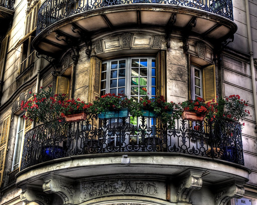 French Balcony in the Modern Interpretation and Decoration. Semicircular Classic balcony with flowerpots