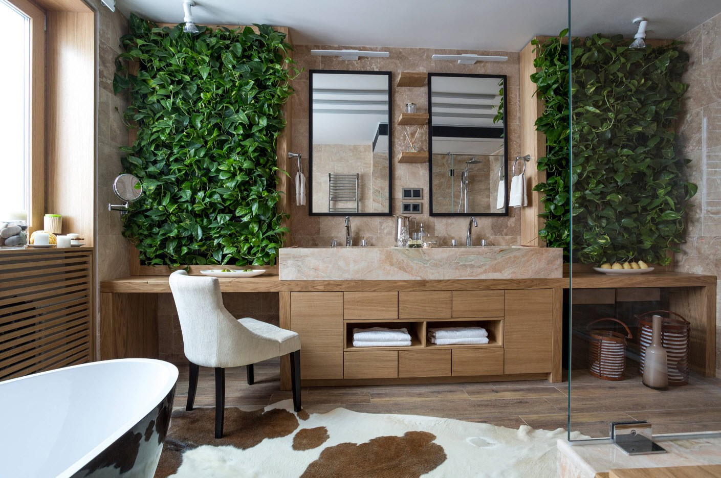 Absoiutely gorgeous design of the eco bathroom with greenery zones at the wall and cow pelt on the floor