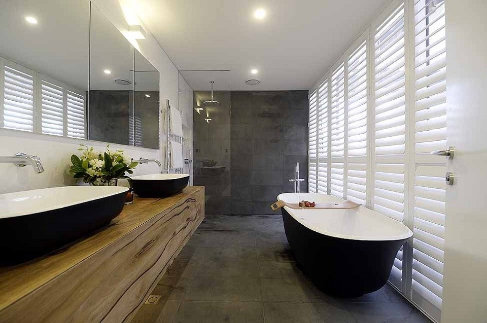 Black Bathroom Interior Design Ideas with Photos and Remodeling Advice. Wooden vanities and gray faux concrete walls