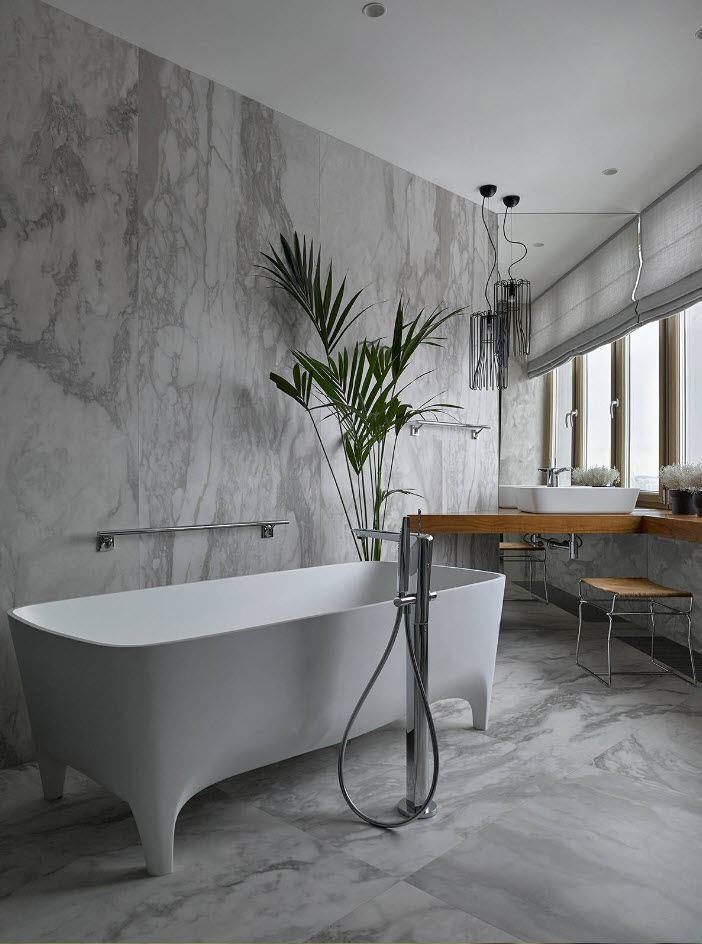 Bathroom Wall Finishing Materials Overview. Natural marble tiles for nice modern room with plants