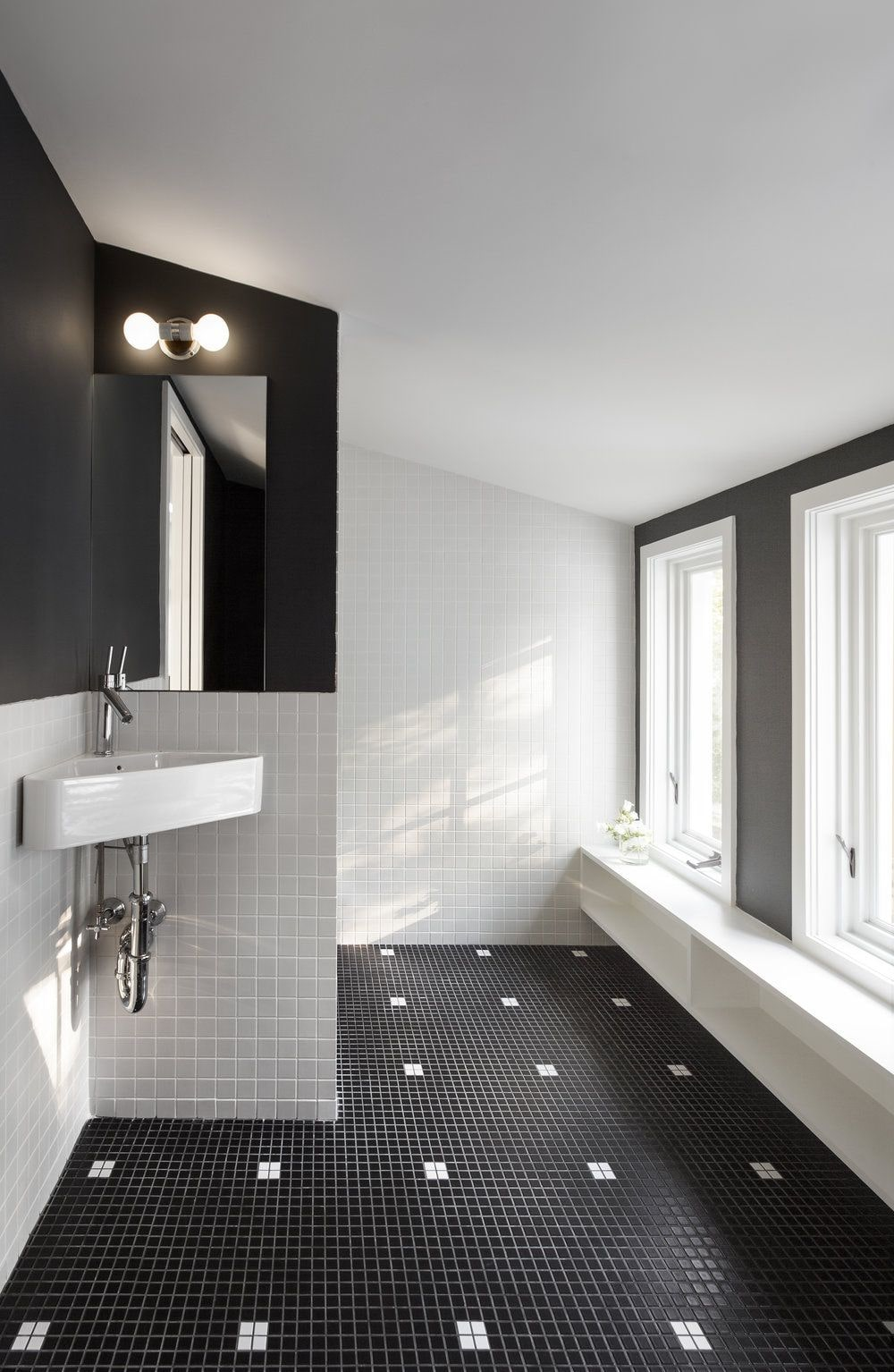 Black Bathroom Interior Design Ideas with Photos and Remodeling Advice. White painted walls and black floor for casual atmosphere