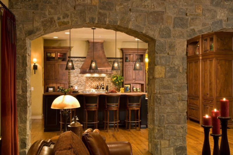 Stone arch between living room and kitchen in old English style