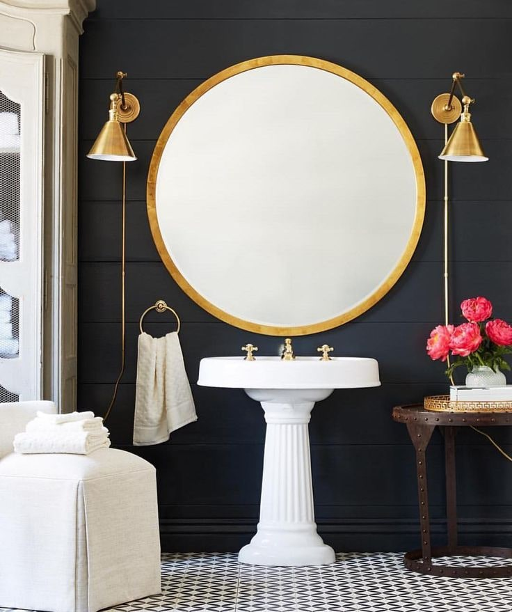 Black Bathroom Interior Design Ideas with Photos and Remodeling Advice. Gilt framed mirror and same colored fixtures