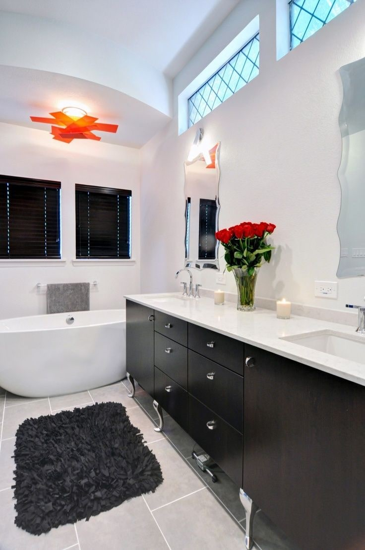 Black Bathroom Interior Design Ideas with Photos and Remodeling Advice. Large vanity for 2-3 persons and the stone bathtub